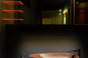 Bathroom with LED illumination, fronts of cupboards in stylized red Iacobel