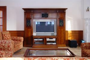 Living room TV and audio-video wall unit, finished in stained oak